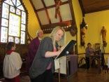 Alecia Carmody signs the Book of the Elect