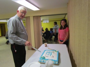 Father Cuts the Cake