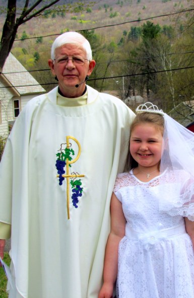 Fr. Tony with our newest 1st Communicant, Natalie Lapa.