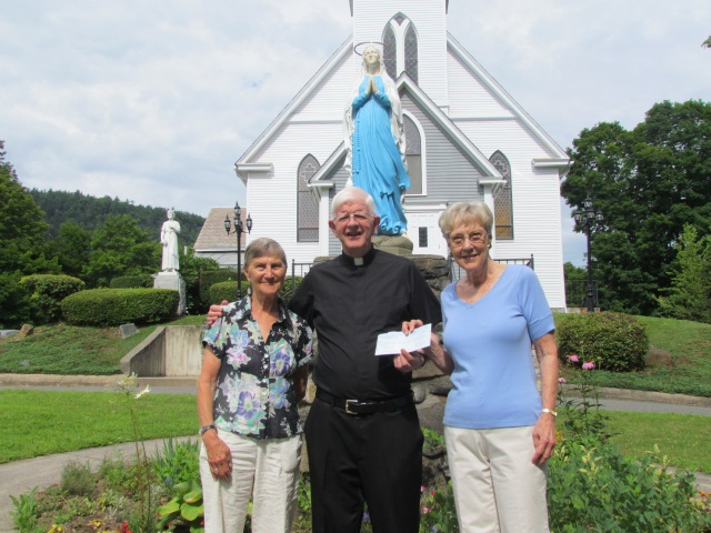 Father Tony presents Change for Babies donation to Susan Maddern [L] and Marie Beeching [R] of Alternative's Pregnancy Center