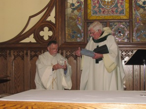 "Deacon Tom is presented a crystal ""sunflower."""