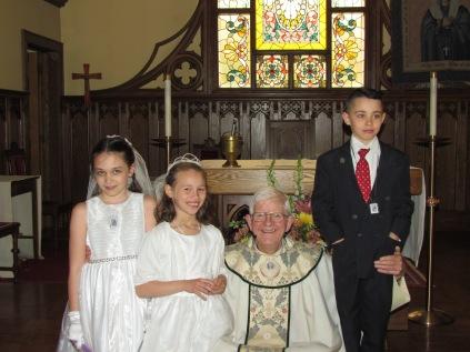 Scarlott Shea, Nina Holan and Caiden Manning w/Fr. Tony